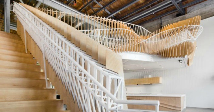 Ultra-twisty wooden and steel staircase seems to 'breathe' as you walk by