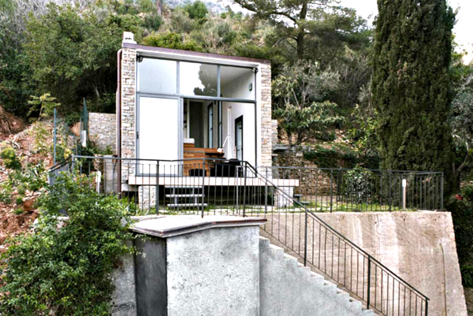 377 Square Foot Home Built Into The Turin Hillside Hides A Full Kitchen Under Stairs