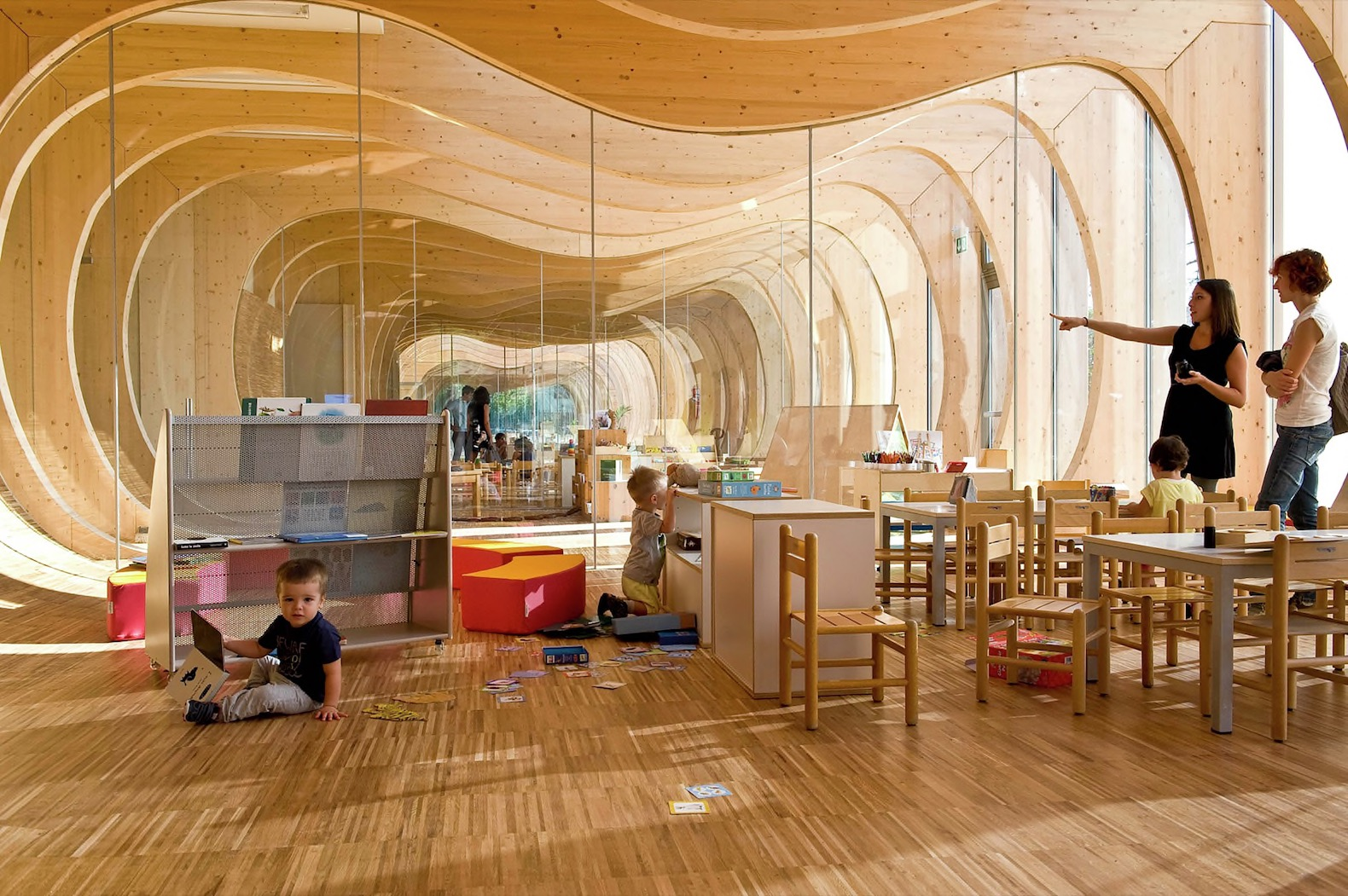 Curvaceous solar powered kindergarten is built from for Space 120 architects