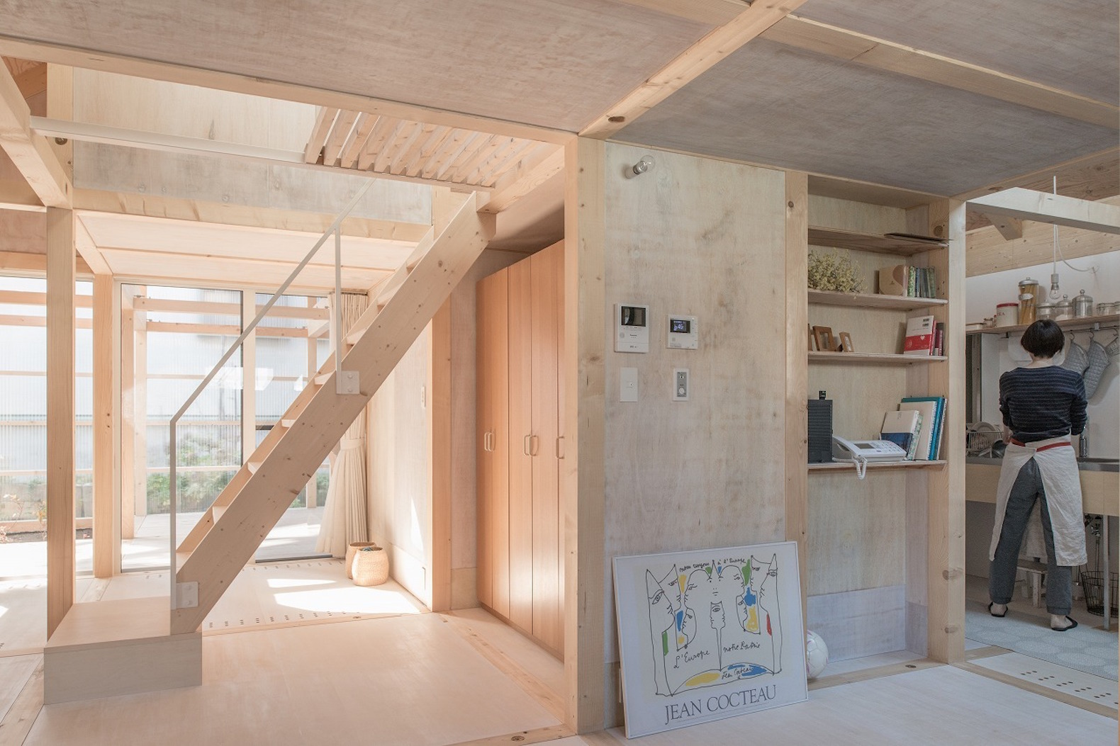 Greenhouse Like Extension Keeps This Minimalist Timber Home Warm In