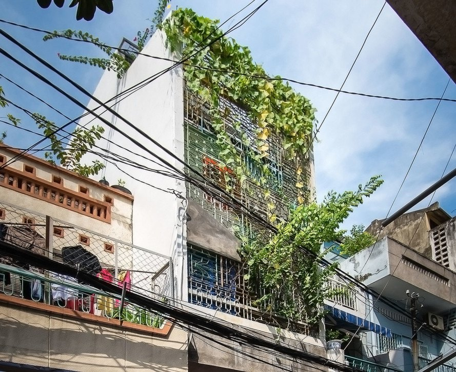 Saigon House, a21studio, Saigon, Vietnam, green architecture, traditional archiecture, sloping roof, antiques, second hand furniture, reclaimed furniture