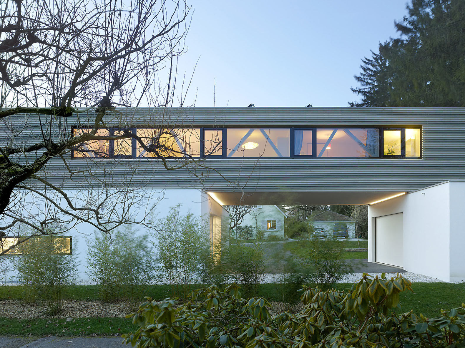 Cantilevered Tannay Bridge House In Switzerland Makes The