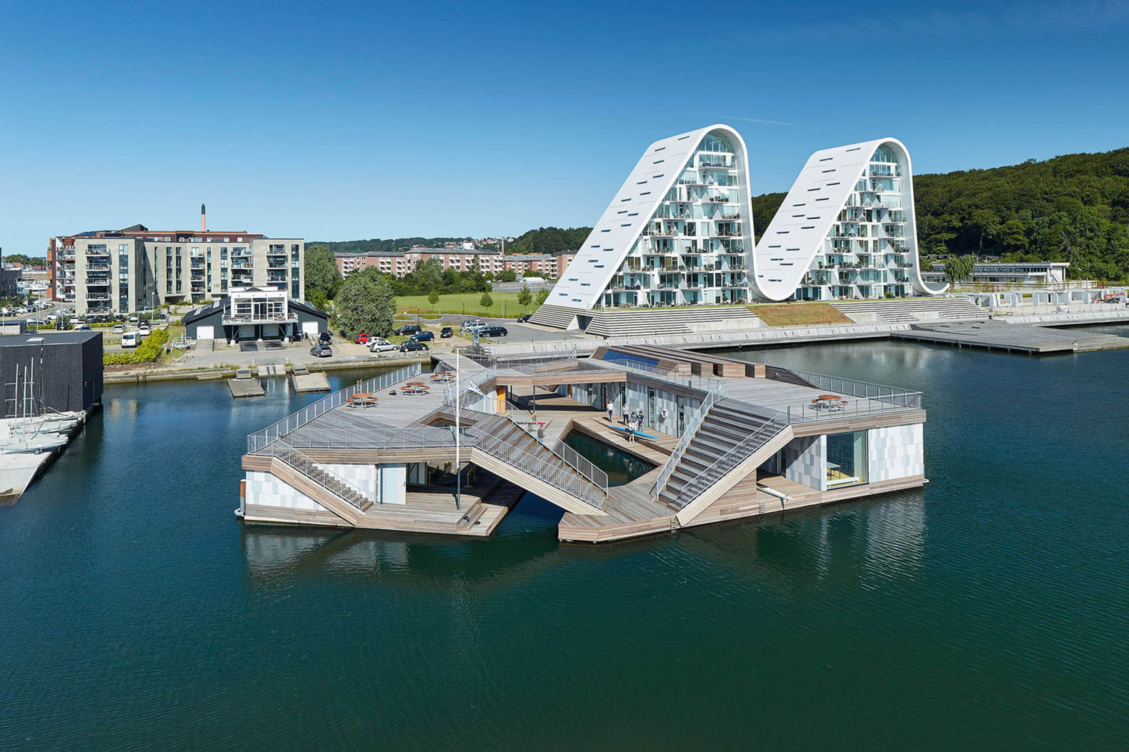 Sculptural floating kayak club doubles as a beautiful community space in Denmark