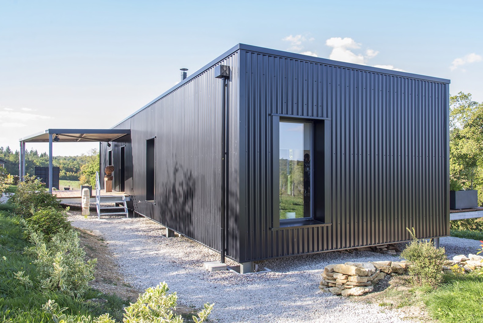 Light filled shipping container home is an artistic for Containers house design