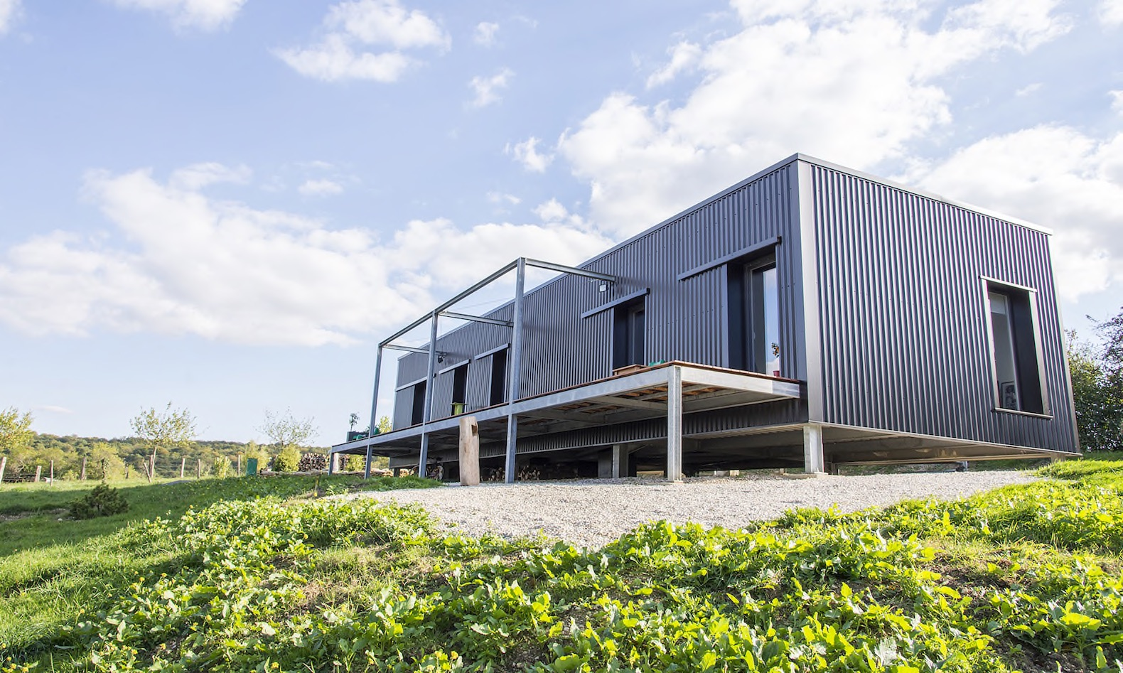 Light filled shipping container home is an artistic