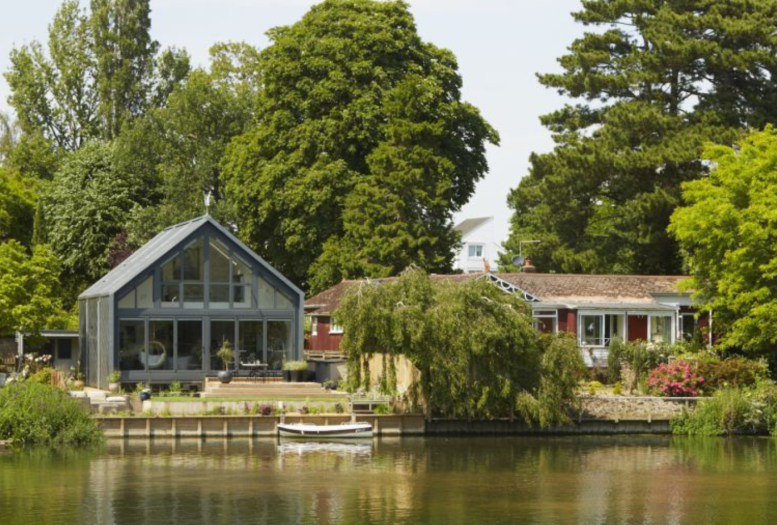 Uk s first amphibious house floats itself to escape for Building a floating home