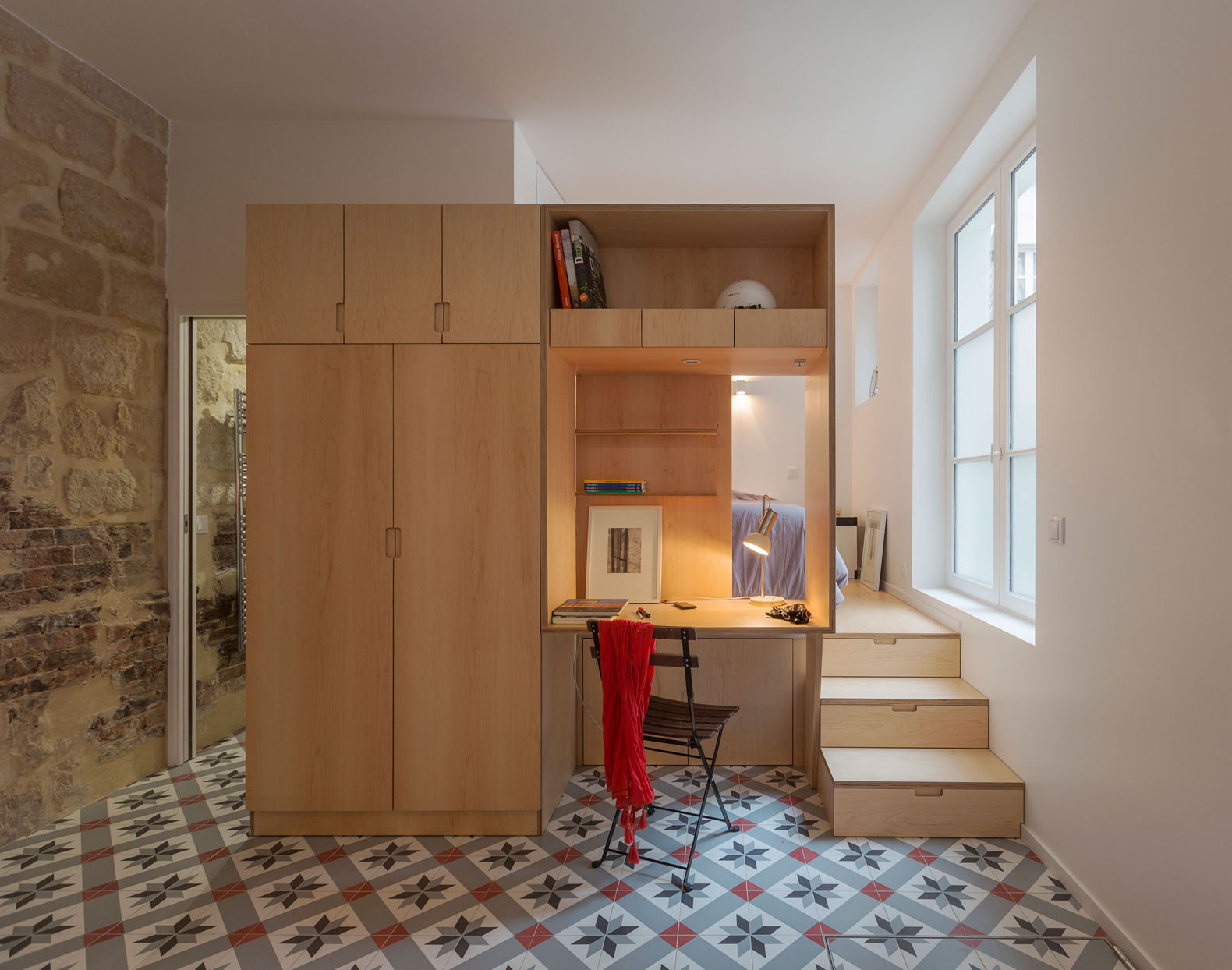 17th century parisian apartment with a hidden slurry pit transformed into an open plan studio