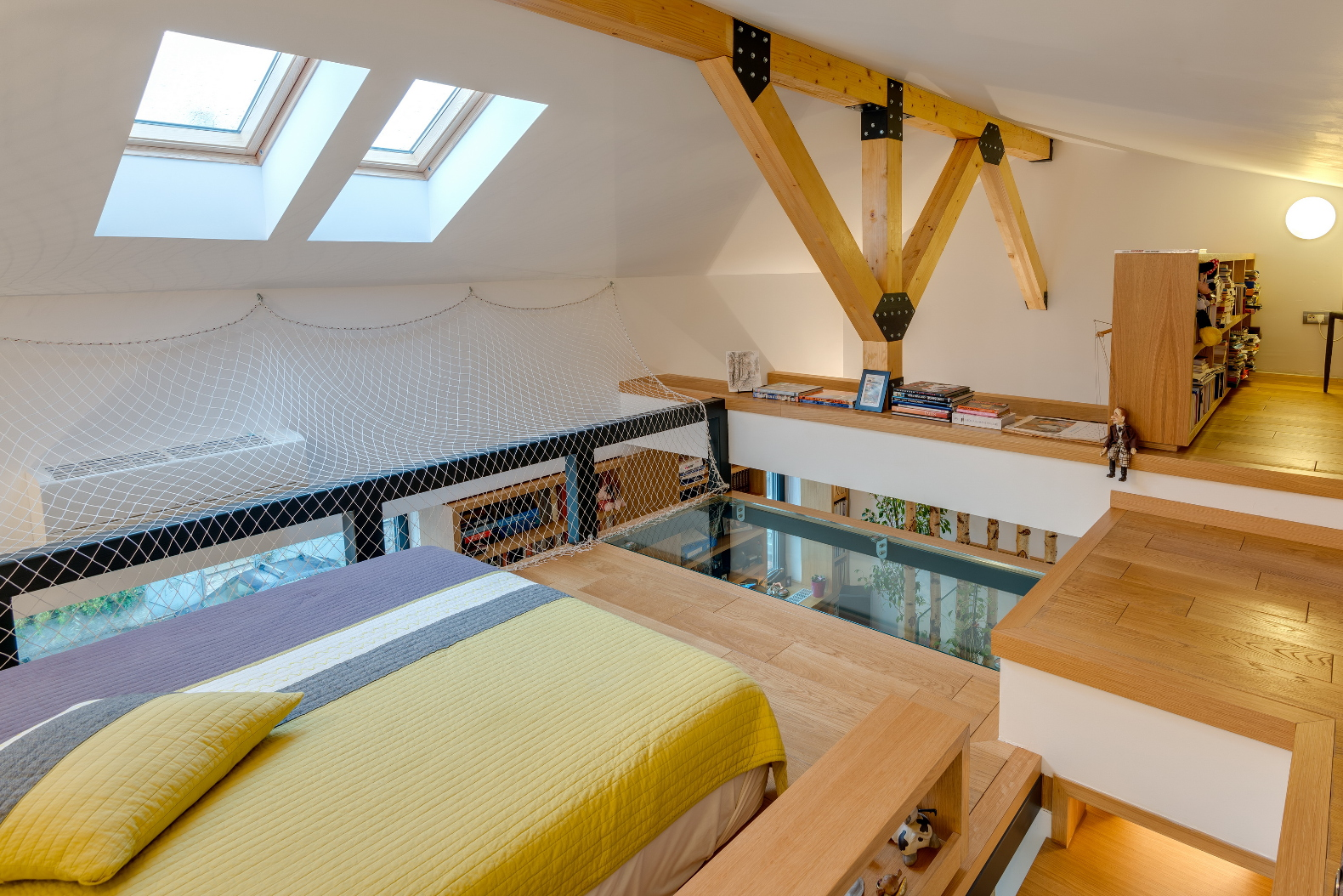 Daring, glass-bottomed loft maximizes space in an edgy Romanian home