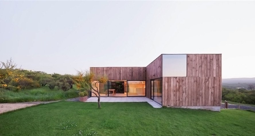 CML House, Ricardo Torrejon Arquitectos, Arturo Chadwick, Chile, wooden house, wood facade, green architecture, natural light, natural building materials, pinwheel layout