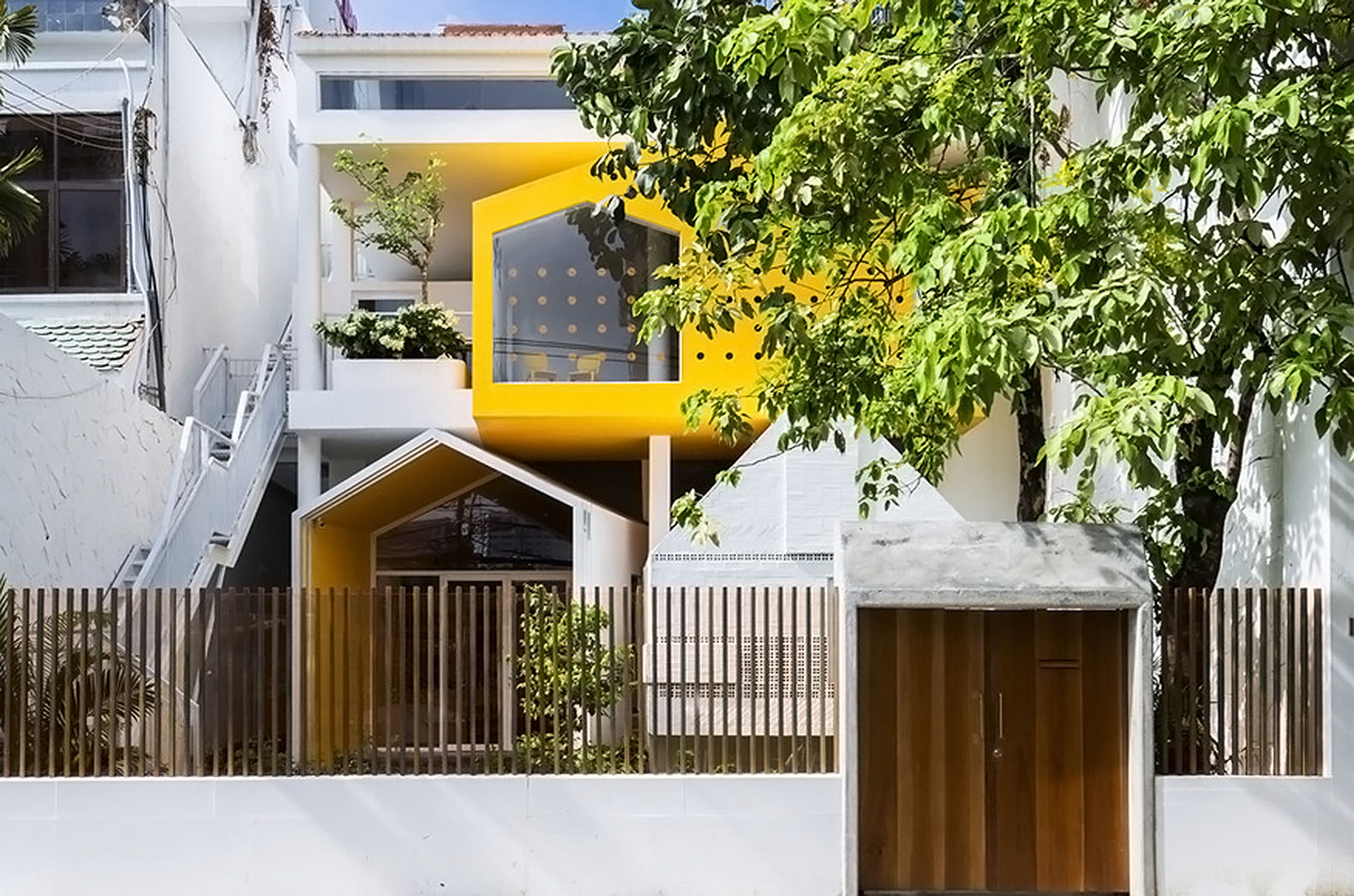 A simple town house transformed into a playful kindergarten in ...