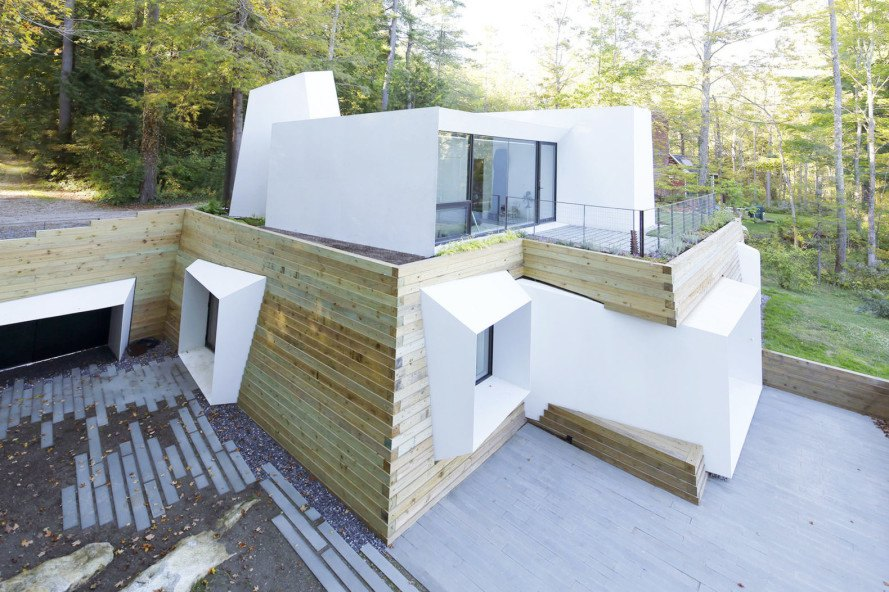 Lake house, Taylor and Miller Architecture and Design, timber wall, retaining wall, abstract design, green architecture, Massachusetts, skylights, natural light