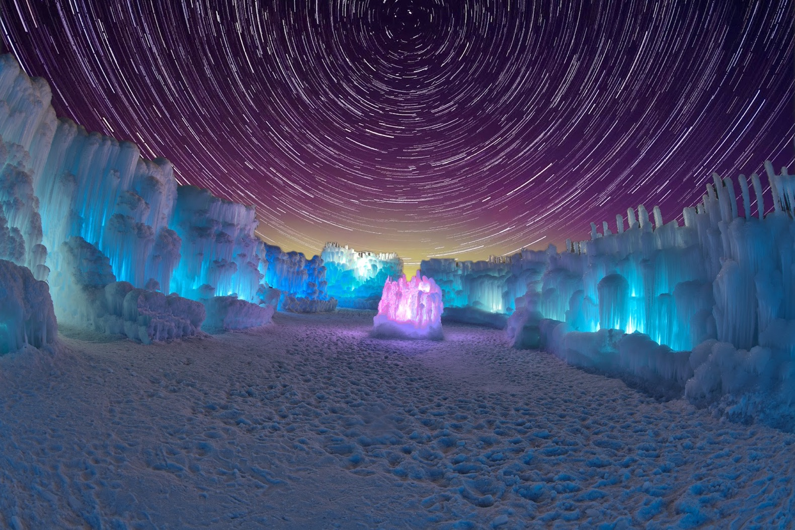 These Gigantic Glowing Ice Castles Take The Sting Out Of
