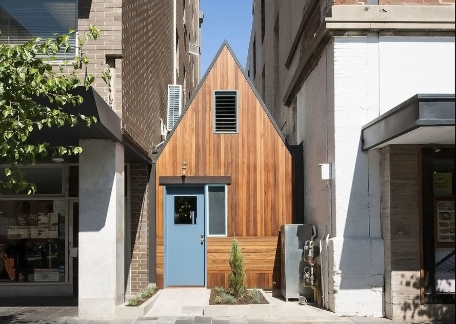Mountain inspired pink moon saloon is a super narrow bar for Courtyard home designs adelaide