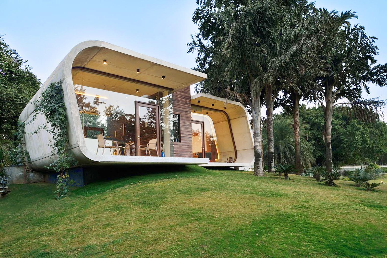 42mm Architecture's sculptural Pool House in India is wrapped in a curved concrete shell