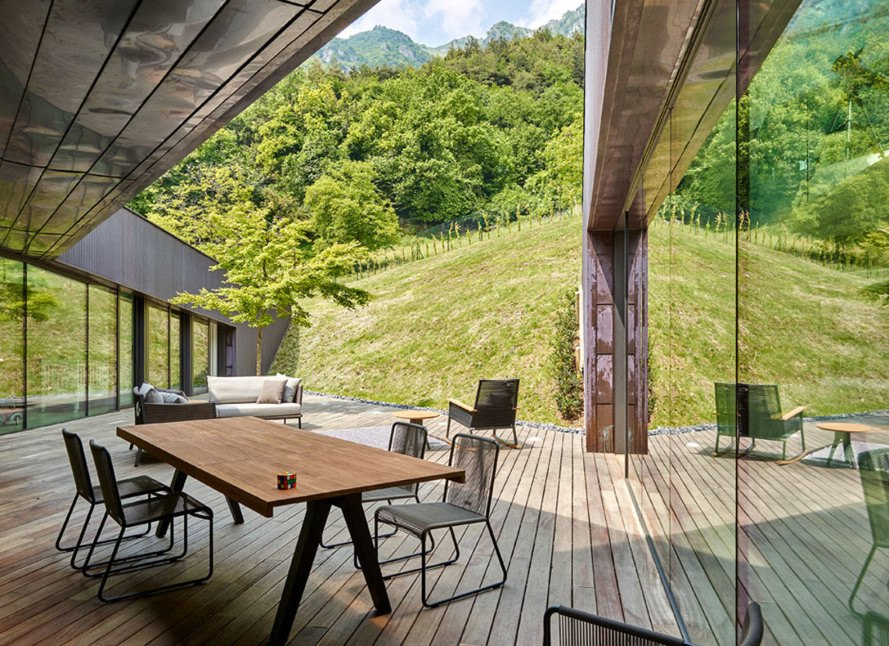 Alpine residence Italy, Alps Villa, Camillo Botticini, Alpine architecture, wood and copper villa, sunken courtyard, geothermal energy, sunken courtyard, natural ventilation, wood patio, corrugated copper cladding, green architecture, Italy