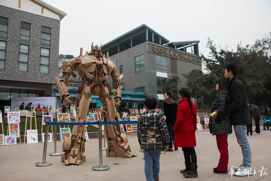 cardboard art, cardboard sculpture, upcycled art, cardboard Optimus Prime, Transformers bot sculpture, cardboard Transformers bot, upcycled cardboard, incredible cardboard robot,