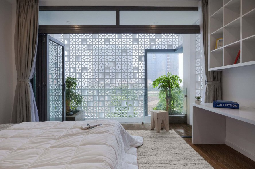 Cocoon Hous, Vietnam, green renovation, row house, perforated brick facade,perforated facade, brickwork, natural ventilation, vertical garden, Landmak Architecture