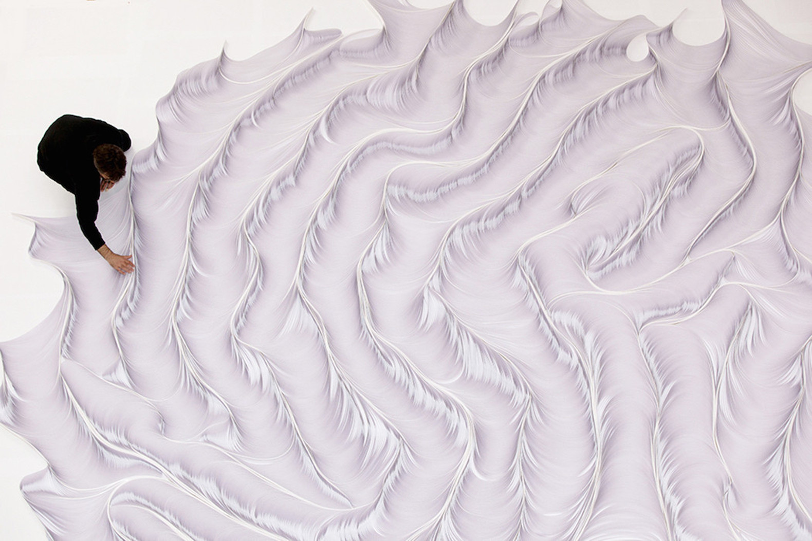Milan artist creates remarkable handcrafted wave sculptures out of paper