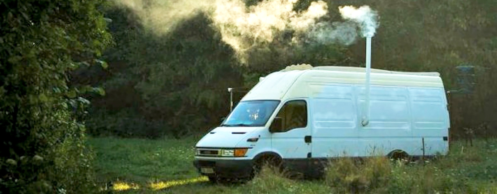 Amazing DIY Van Conversion Boasts A Wood Burning Stove And Chimney