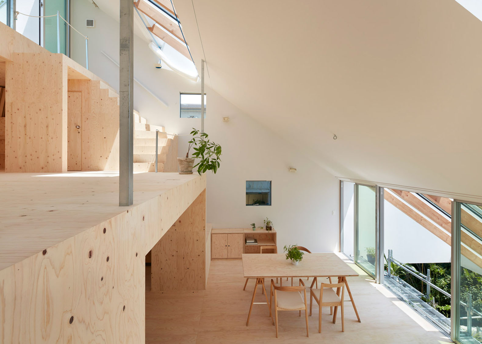 Skylights and clerestory windows bathe the japanese re slope house in natural light inhabitat - Skylight house plans natural light ...