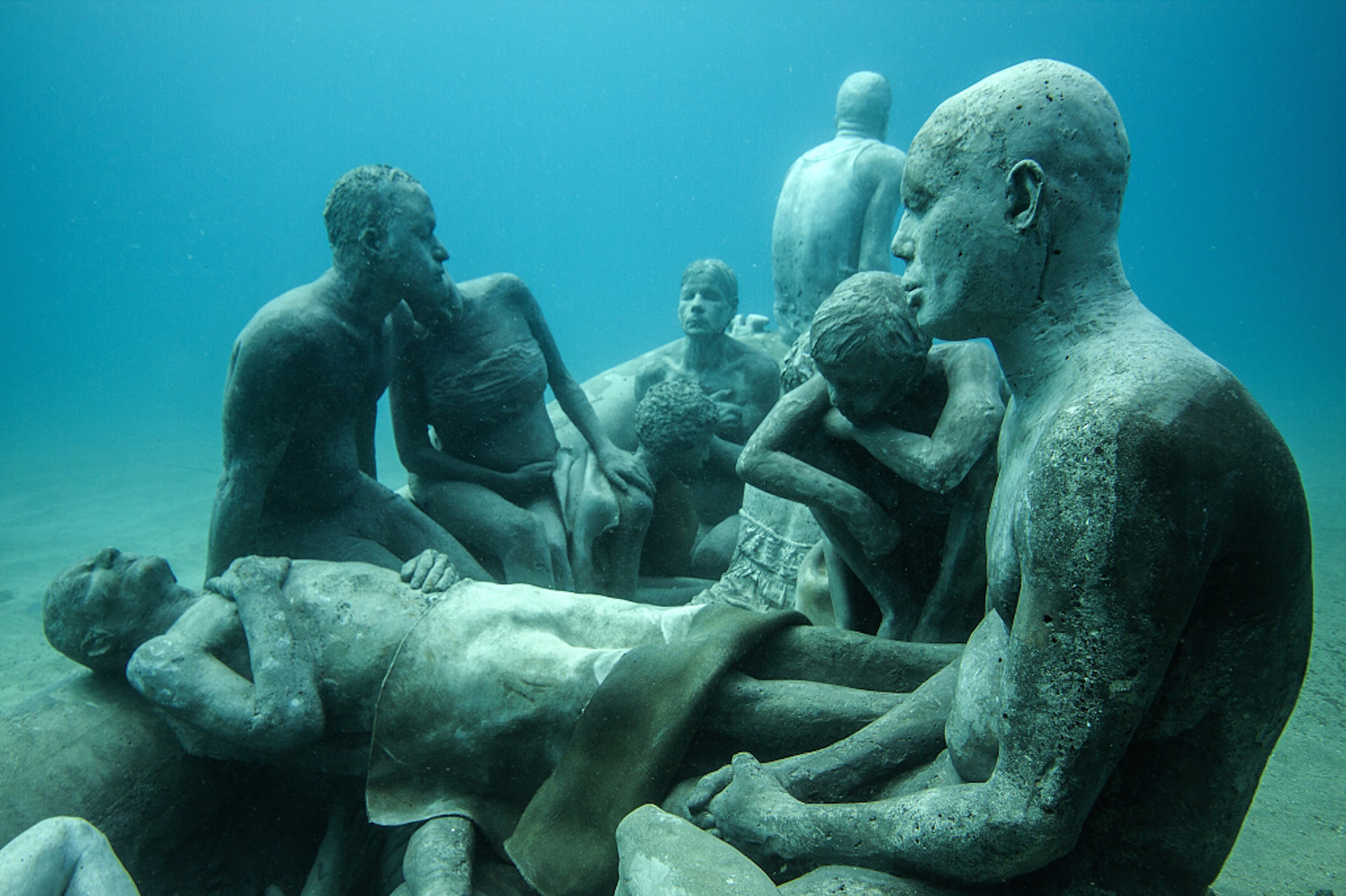 Haunting drowned figures send a chilling message in Europe's first undersea sculpture museum