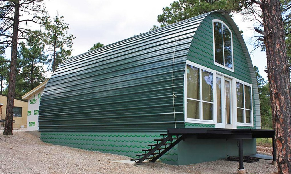Prefabricated arched cabins can provide a warm home for for Build a house for under 5000 dollars