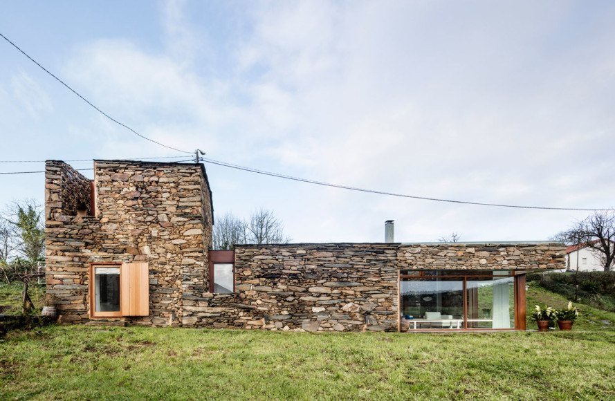 Galicia wine cellar house, wine cellar, Spain, green renovation, drystone walls, renovated wine cellar, Cubus Arquitectura, skylights, courtyard, natural light, cross ventilation
