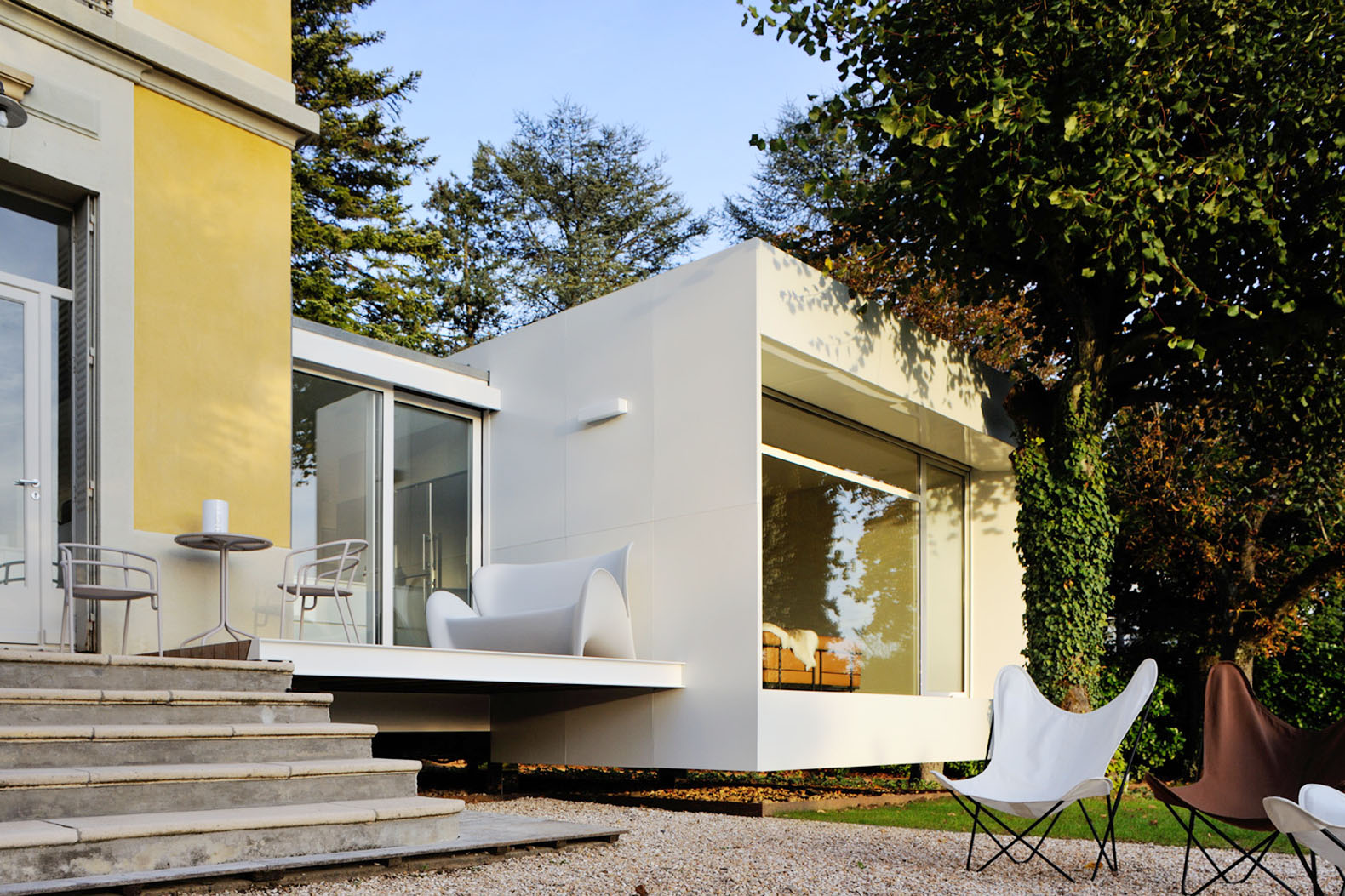 Tiny Floating Cube Extends A Charming 19th Century House In France