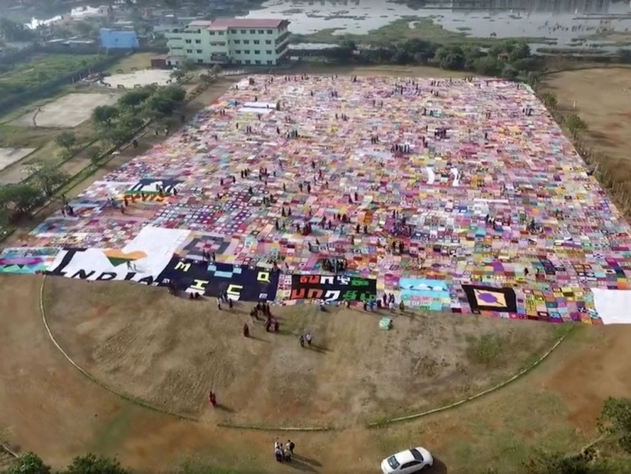Thousands of women create world's largest crochet blanket in India