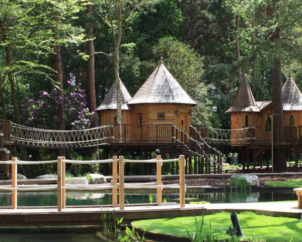 Blueforest, Treehouse, Treehouse Village, Treehouse Complex, Fairytale treehouse village, treehouse village in Surrey, fairytale turrets and a copper roof, Surrey treehouse village, luxury treehouse village, kebony wood, At the Water's Edge