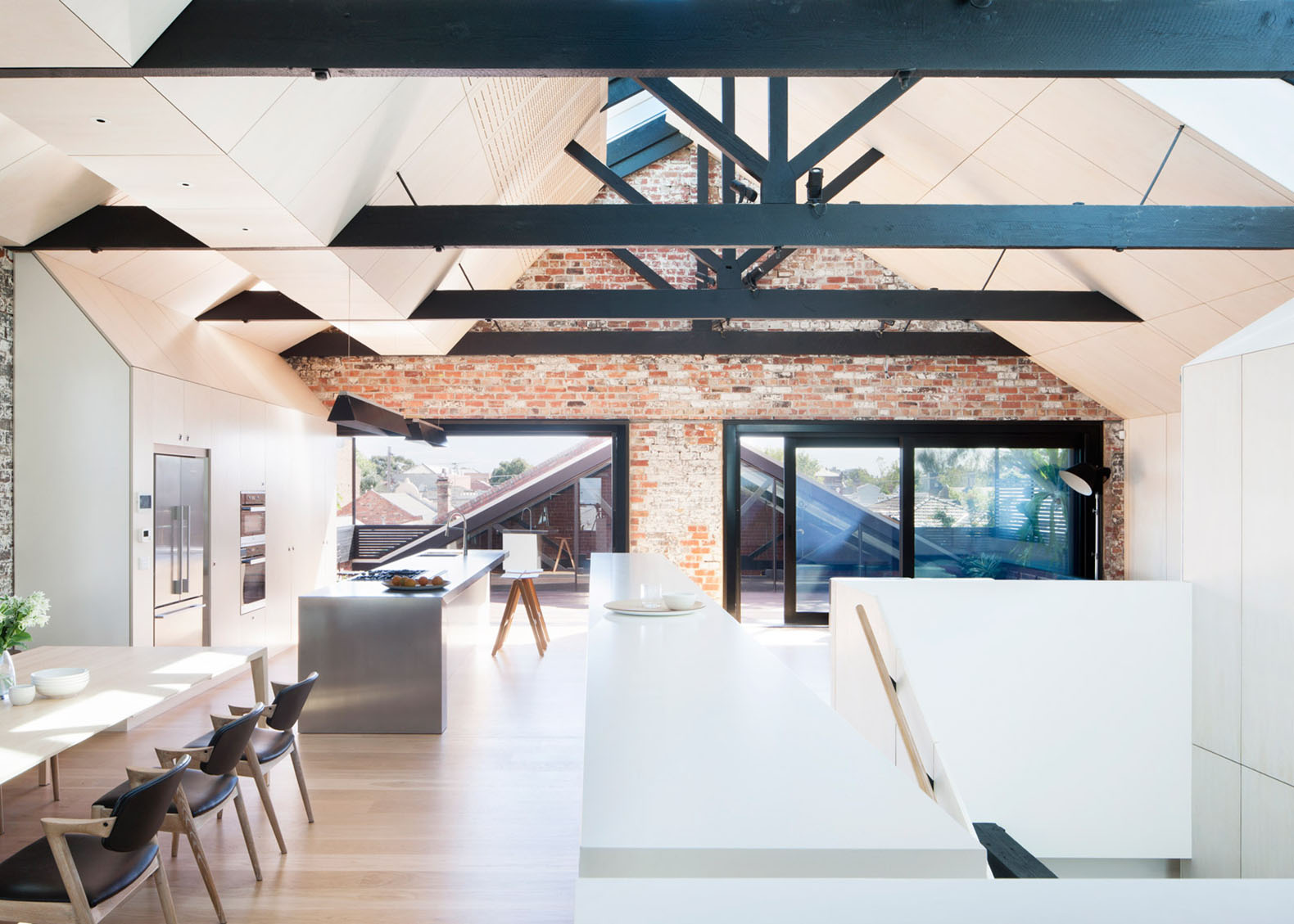 Neglected brick warehouse converted into a daylit home for - Warehouse turned into home ...