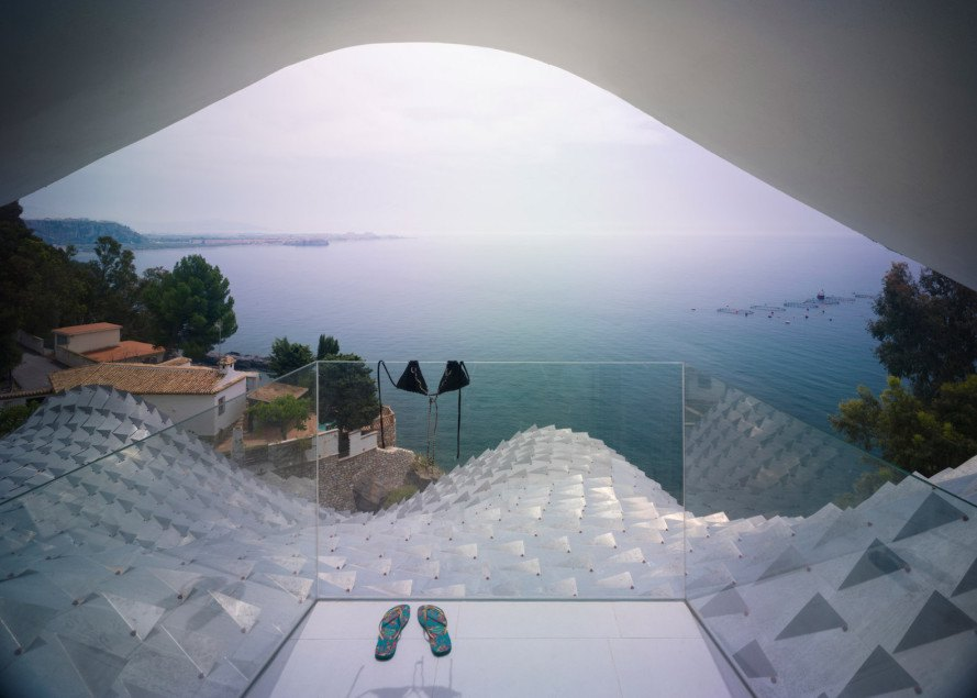 House on the Cliff in Spain, House on the Cliff by GilBartolomé Architects, Casa del Ancantilado by GilBartolomé Architects, Gaudi-inspired house, amazing cliffside house Spain, futuristic cliffside home, fiberglass furniture, polyester resin furniture