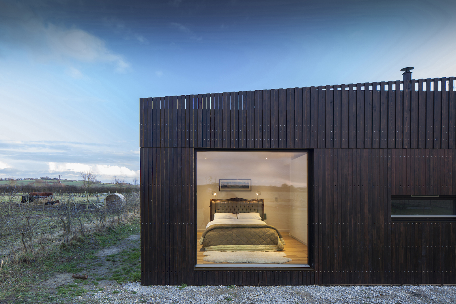 Howe farm is an air tight timber clad farmhouse with a for Farmhouse architecture