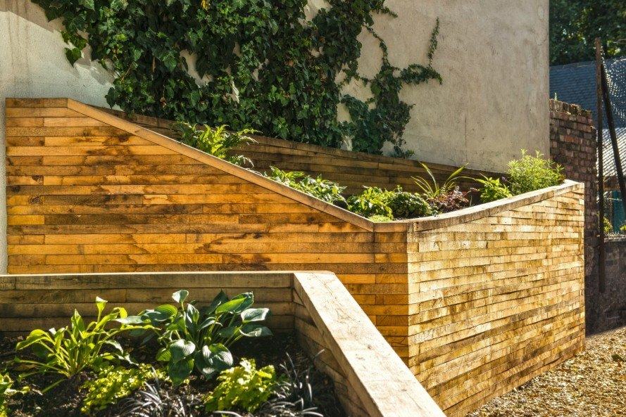 Wildstone designers, Lambeth Palace Road, pocket gardens, urban design, hybrid advertising space and community garden, Anti-social behaviour london, london community gardens, urban gardens, landscape design, wooden crates, sustainably sourced oak timber