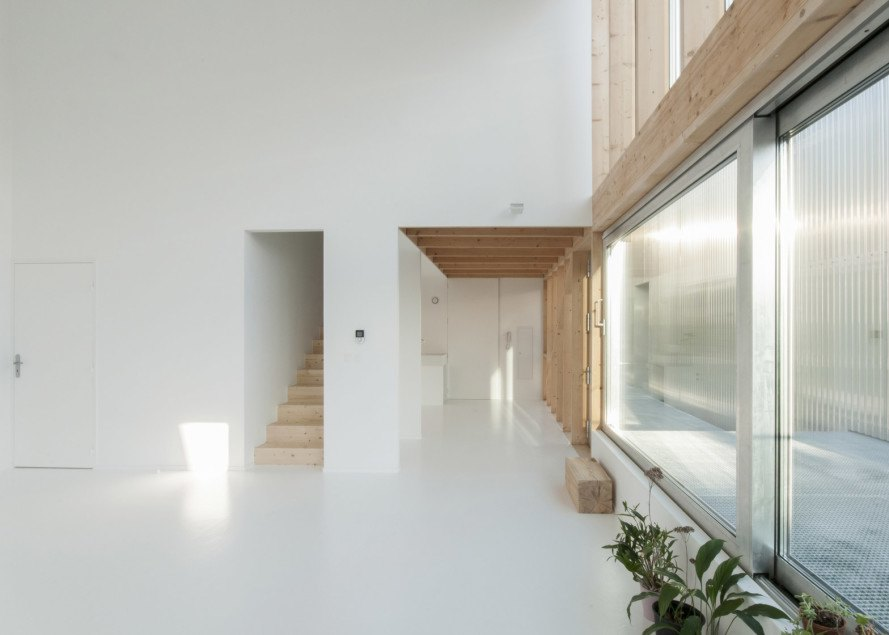 barn turned into apartments, adaptive reuse barn, adaptive reuse rural architecture, Sud by GENS, fiber cement shingled architecture, adaptive reuse social housing, Velle-sur-Moselle converted barn