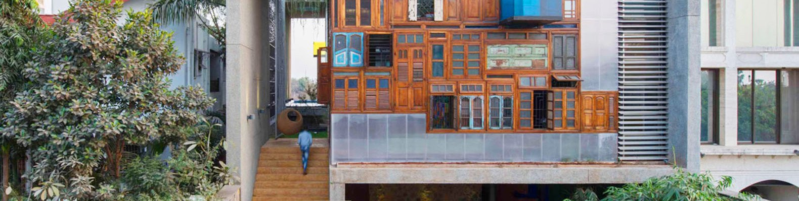 A colorful facade of recycled doors and windows adorns this unique Mumbai residence | Inhabitat - Green Design Innovation Architecture Green Building & A colorful facade of recycled doors and windows adorns this unique ... Pezcame.Com