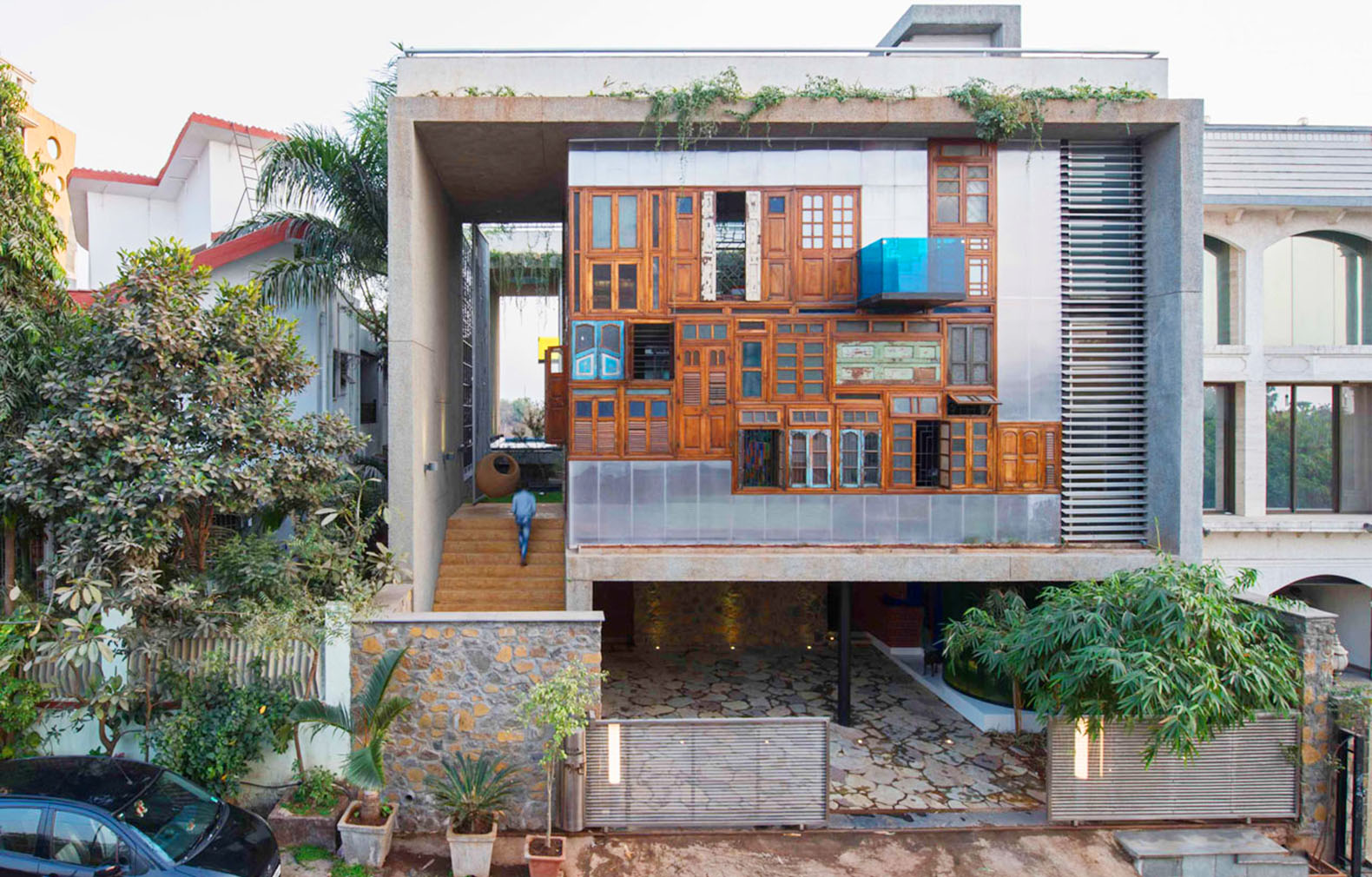 A colorful facade of recycled doors and windows adorns this unique Mumbai residence & Recycled Doors | Inhabitat - Green Design Innovation ... Pezcame.Com