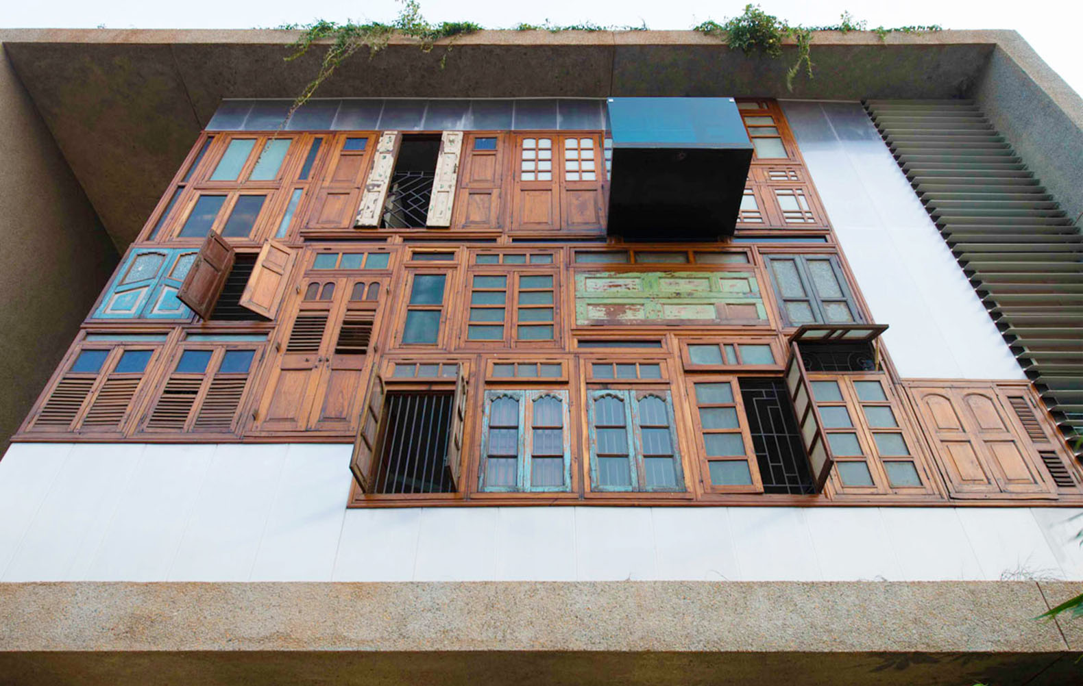 Collage House Mumbai S+PS Architects recycled doors recycled materials & A colorful facade of recycled doors and windows adorns this unique ... Pezcame.Com