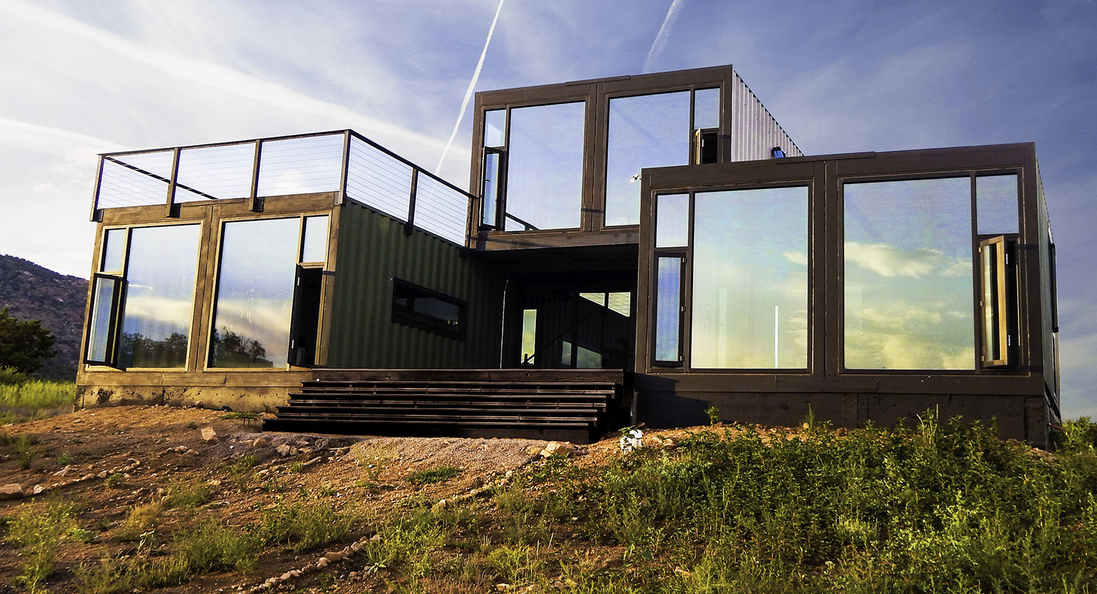 A glazed container cabin that reflects the Colorado sky