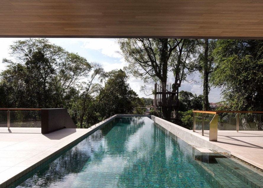 Gallop House, Singapore, timber-clad house, Formwerks Architects, timber screens, wooden louvers, locally sourced wood, treehouse, swimming pool, green architecture