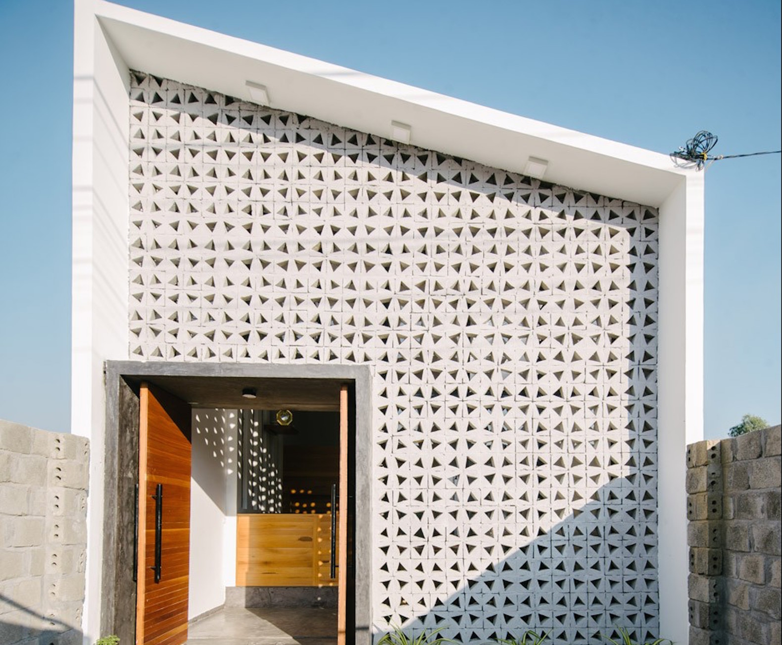low cost perforated home in vietnam shows off the charms of concrete architecture - Who Designed The Vietnam Wall