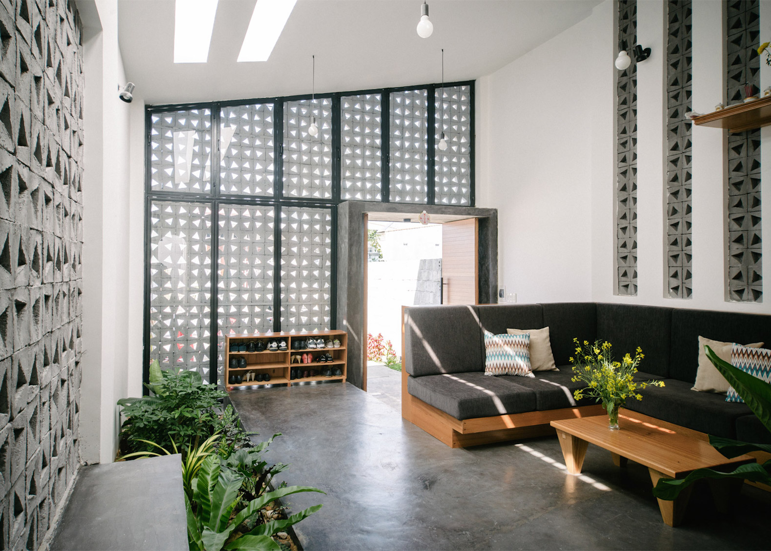 low cost perforated home in vietnam shows off the charms of