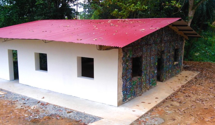 World's first plastic bottle village, plastic bottle village, plastic bottle house Panama, Panama plastic village, Isla Colon, Bocas Del Toro, houses that recycled plastic, village recycles 1 million PET bottles, plastic house building, village of plastic bottle houses