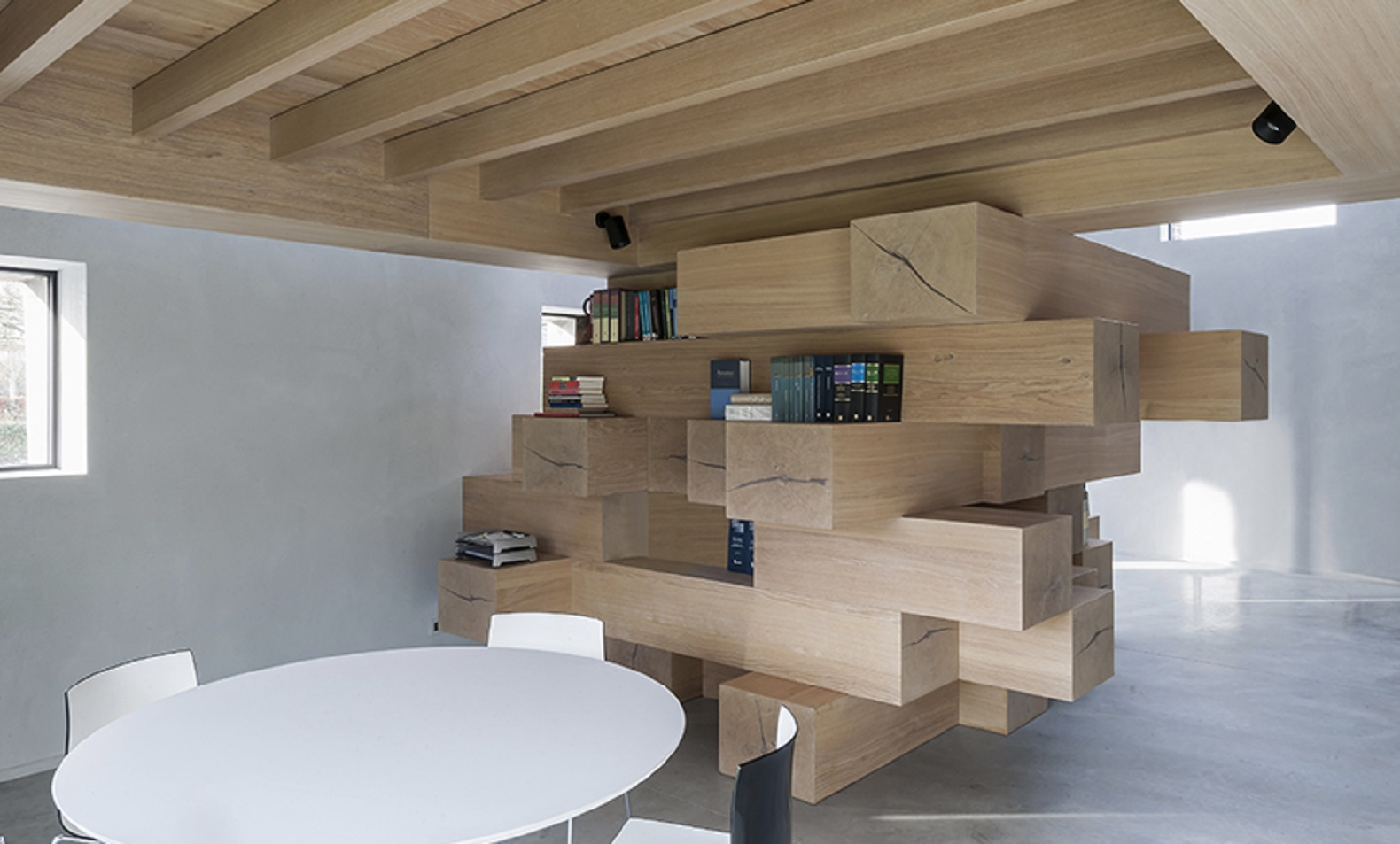 Stacked timber beams act as multi use office furniture in How to renovate old furniture