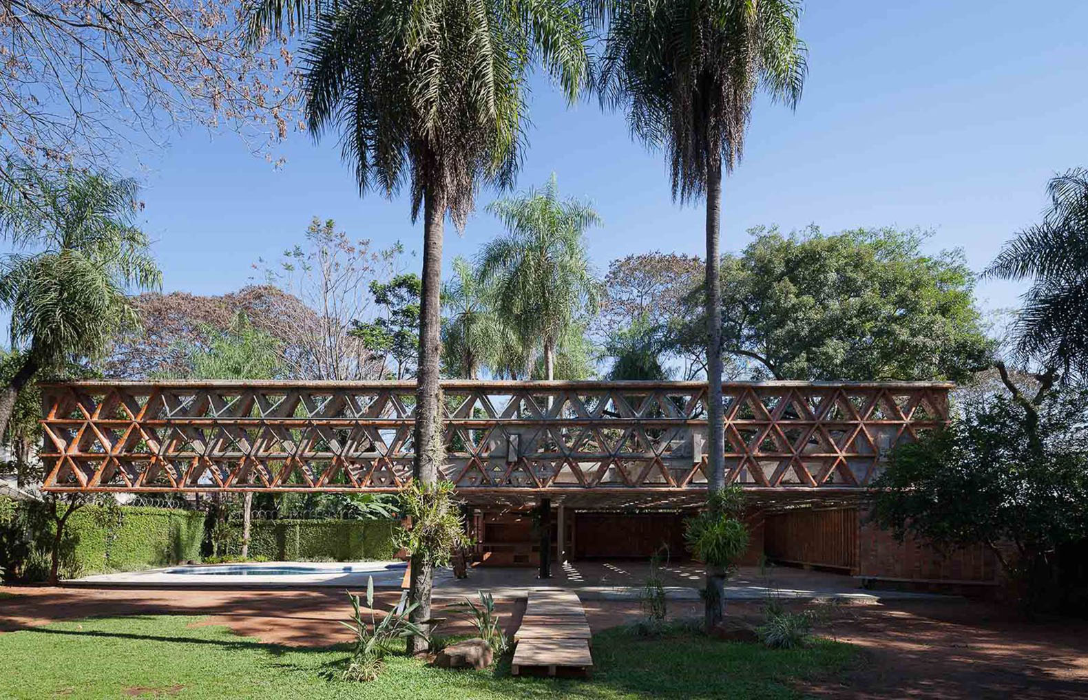 huge lattice canopy made with brick and steel shelters paraguay's