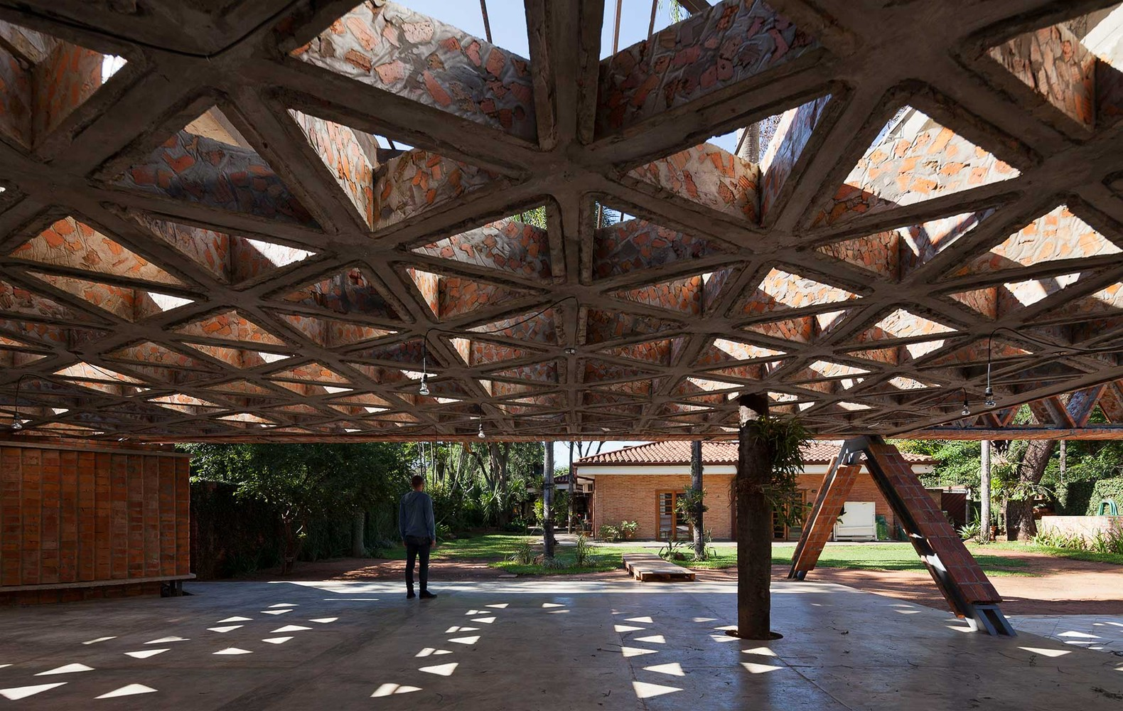 Huge Lattice Canopy Made With Brick And Steel Shelters
