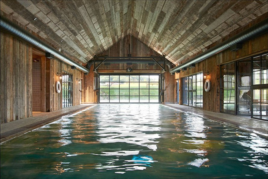 Michaelis Boyd, Soho House, Soho Farmhouse, England, countryside retreat, green retreat, London, private club, green architecture, infinity pool, communal spaces, mezzanine, sauna, kids playground, cabins