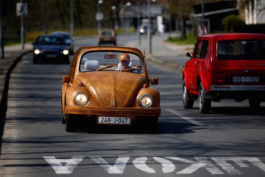 timber VW beetle by Momir Bojic, VW car covered in wood, timber VW car in Bosnia