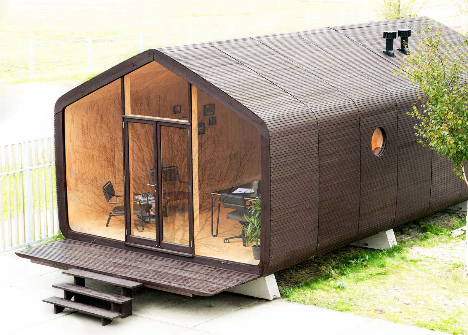 Modular Wikkelhouse wrapped in 24 layers of cardboard snaps