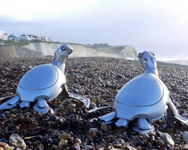 Hubcap creatures by Ptolemy Elrington, hubcap sculpture, recycled hubcaps, upcycled hubcaps. hubcap animal sculptures